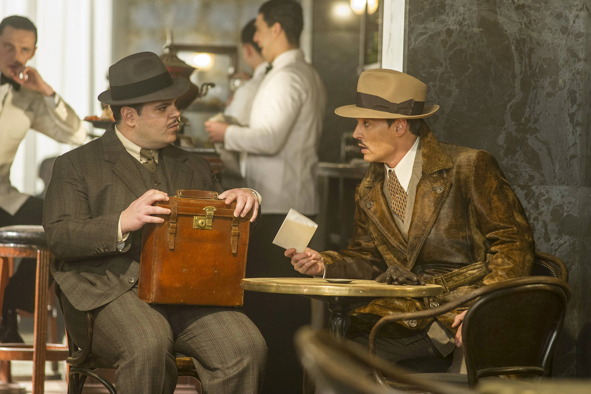 Photo by Nicola Dove/Twentieth Century Fox                                 Josh Gad, left, and Johnny Depp star in Murder on the Orient Express.