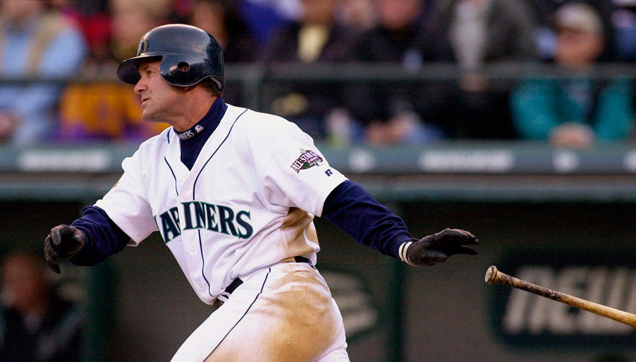The Mariners' Edgar Martinez drops his bat as he heads toward first on a two-run double against the Athletics on April 4, 2001, in Seattle. (Elaine Thompson / AP Photo)
